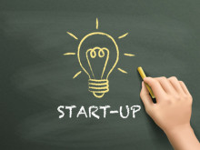 start-up word written by hand